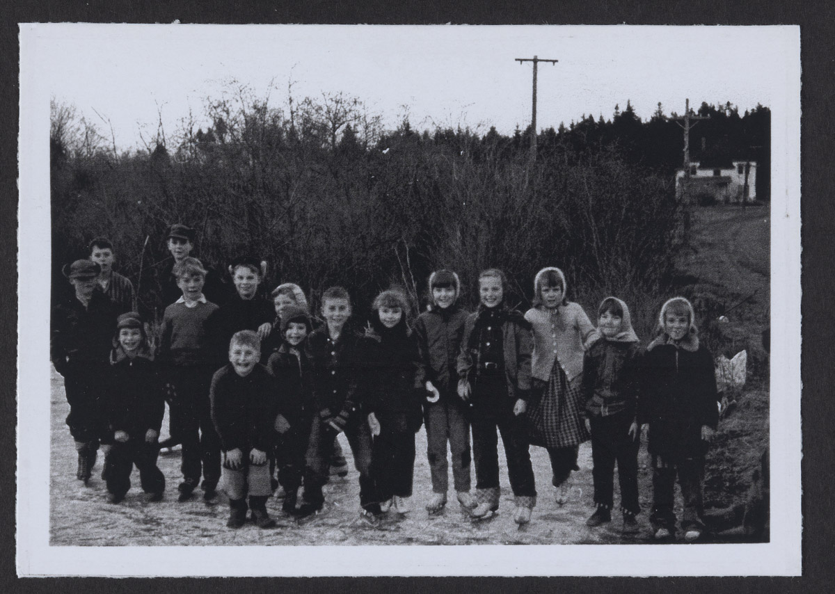 Children from Swans Island Wearing Ice Skates Photograph 1