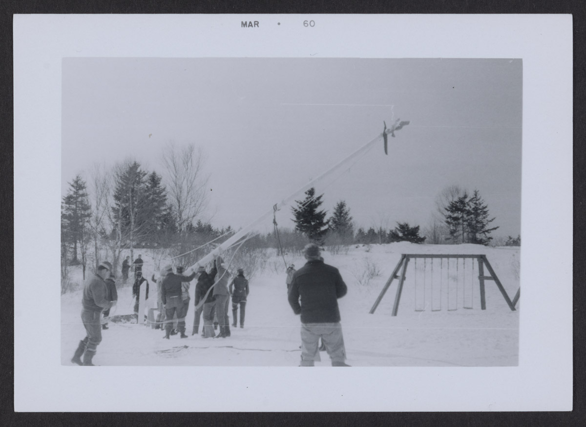 Raising the Swans Island School Flag Pole Photograph, March 1960