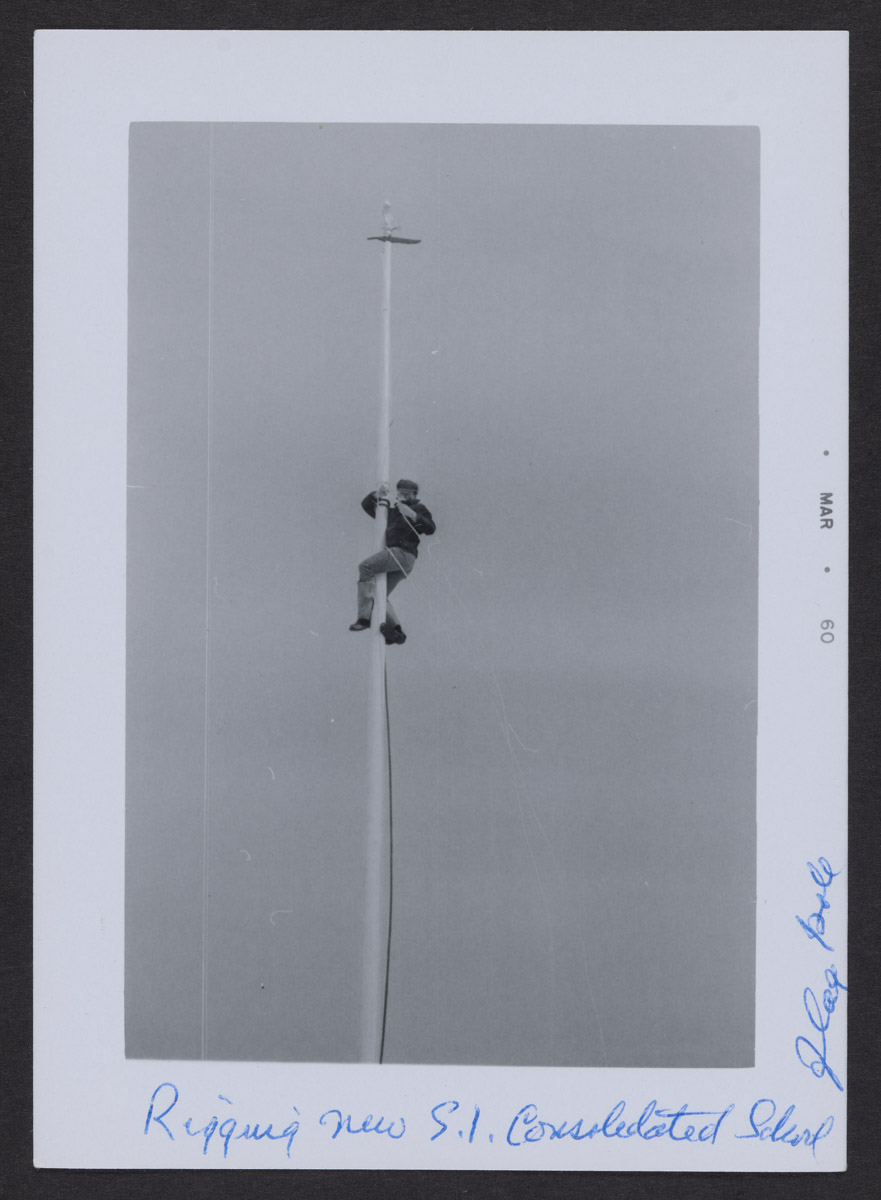 Rigging the Swans Island School Flag Pole Photograph, March 1960